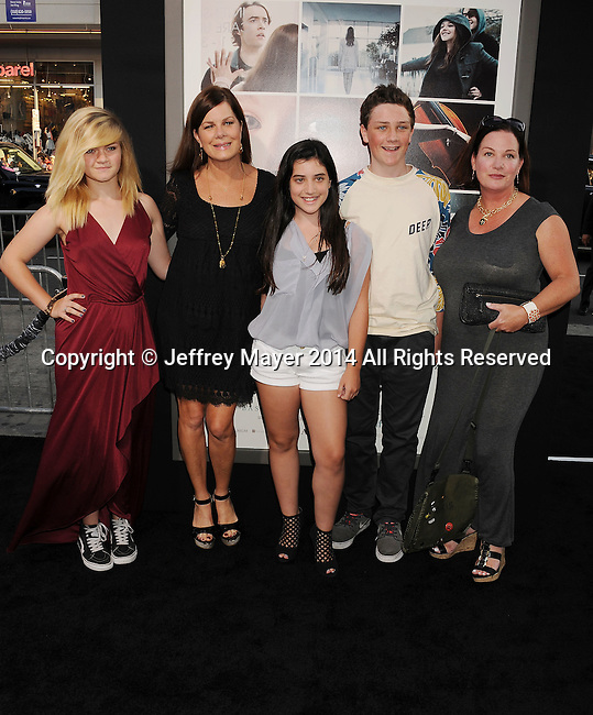 HOLLYWOOD, CA- AUGUST 20: Actress Marcia Gay Harden (2nd from L) and family arrive at the Los Angeles premiere of 'If I Stay' at TCL Chinese Theatre on August 20, 2014 in Hollywood, California.