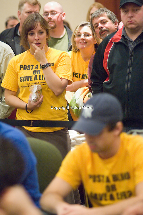Steven Black's sister, Stephanie, reacts as he plays.