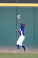 Jean Ramon #1 of the Rancho Cucamonga Quakes makes a catch near the outfield wall against the High Desert Mavericks at The Epicenter in Rancho Cucamonga,California on May 8, 2011. Photo by Larry Goren/Four Seam Images