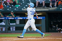 Ashton McGee (36) of the North Carolina Tar Heels follows through on his solo home run in the bottom of the fourth inning against the Miami Hurricanes in the second semifinal of the 2017 ACC Baseball Championship at Louisville Slugger Field on May 27, 2017 in Louisville, Kentucky.  The Tar Heels defeated the Hurricanes 12-4.  (Brian Westerholt/Four Seam Images)