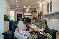 Army soldier father with his family inside at home, stock photo, DOD complient, rights managed, model released