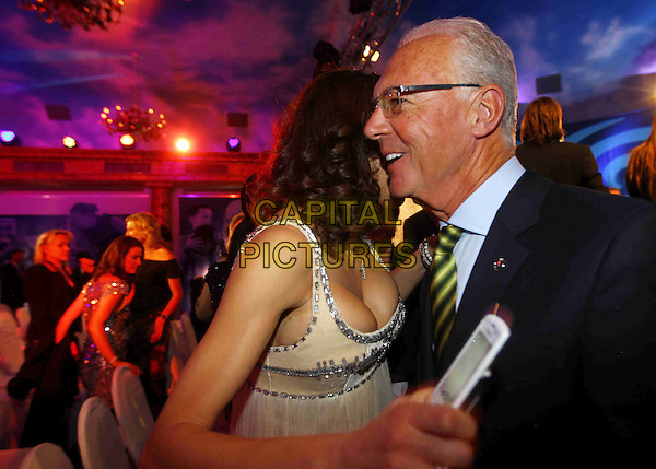"Sharlely ""Lilly"" Kerssenberg, Franz Beckenbauer.Laureus Media Award 2011 at Grand Tirolia Golf & Ski Resort, Kitzbuehel, Austria..November 14th, 2011.half length black dress white cleavage suit profile .CAP/PPG/WS.©Willi Schneider/People Picture/Capital Pictures"