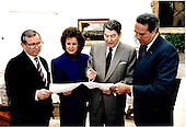 United States President Ronald Reagan, right center, confers with Chief of Staff Howard Baker, left, U.S. Secretary of Transportation Elizabeth Dole, left center, and U.S. Senate Republican Leader Bob Dole (Republican of Kansas) on strategy to sustain his veto of House Resolution 2, the Highway Bill in the Oval Office of the White House in Washington, DC on March 23, 1987..Mandatory Credit: Terry Arthur - The White House / CNP