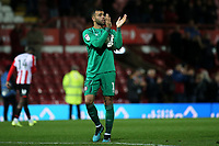 Brentford goalkeeper, David Raya, applauds the home fans at the final whistle during Brentford vs Bristol City, Sky Bet EFL Championship Football at Griffin Park on 2nd October 2019