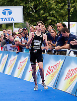 25 JUL 2010 - LONDON, GBR -  Alistair Brownlee struggles to reach the finish line at the end of the mens race of the London round of the ITU World Championship Series triathlon .(PHOTO (C) NIGEL FARROW)