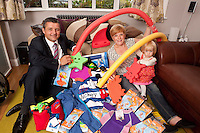 Young Florence Cuthbert isn't quite two, but she was pleased to receive an early birthday present in the shape of a pile of swimming goodies from Computershare Voucher Services sales director Iain Williamson. Florence is also pictured with her mum Kate.