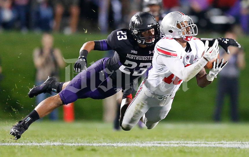 Ohio State Buckeyes wide receiver Philly Brown (10) dives to catch a pass while defended by Northwestern Wildcats cornerback Nick VanHoose (23) during Saturday's NCAA Division I football game at Ryan Field in Evanston on October 5 2013. (Barbara J. Perenic/The Columbus Dispatch)
