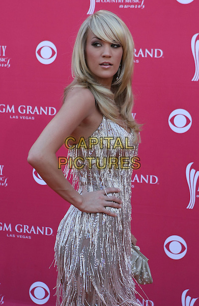 CARRIE UNDERWOOD.The 43rd Annual Academy of Country Music Awards (ACM) held at MGM Grand Garden Arena, Las Vegas, Nevada, USA..May 18th, 2008.half length silver tassels dress hand on hip.CAP/ADM/MJT.© MJT/AdMedia/Capital Pictures.