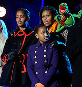 First Lady Michelle Obama, daughters Malia, left, Sasha, right, and Kermit the Frog sing during the 2011 National Christmas Tree Lighting on the Ellipse in Washington, DC, on Thursday, December 1, 2011.     .Credit: Roger L. Wollenberg / Pool via CNP