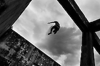 Jose Rodriguez, a freerunner from Plus Parkour team, jumps from the top of the ruined walls during a free running training session in the outskirts of Bogotá, Colombia, 22 February 2016. Parkour, originally developed in France during the late 1980s from military training, is a physical activity, focused on the art of movement and overcoming obstacles in a strictly urban environment. Practitioners of parkour employ running, climbing, jumping, rolling and other movements to pass through any urban area the most efficient way possible.