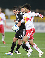 DC United midfielder Chirs Pontius (13) fights for possession of the ball against New York red Bulls midfielder Mehdi Ballouchy (10) The New York Red Bulls defeated DC United 4-0, at RFK Stadium, Thursday April 21, 2011.