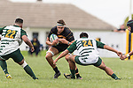 Daniel Stol looks to break the Manurewa defence. Counties Manukau Premier Counties Power Club Rugby Round 4 game between Bombay and Manurewa, played at Bombay on Saturday March 31st 2018. <br /> Manurewa won the game 25 - 17 after trailing 15 - 17 at halftime.<br /> Bombay 17 - Ki Anufe, Chay Macwood tries, Tim Cossens, Ki Anufe conversions,  Ki Anufe penalty. <br /> Manurewa Kidd Contracting 25 - Peter White 2 , Willie Tuala 2 tries, James Faiva conversion,  James Faiva penalty.<br /> Photo by Richard Spranger.