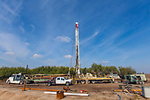Water well being drilled in Almond orchard. After three years of severe drought and groundwater depletion, a record number of well drilling permits have been granted, Tulare County, San Joaquin Valley, California, USA