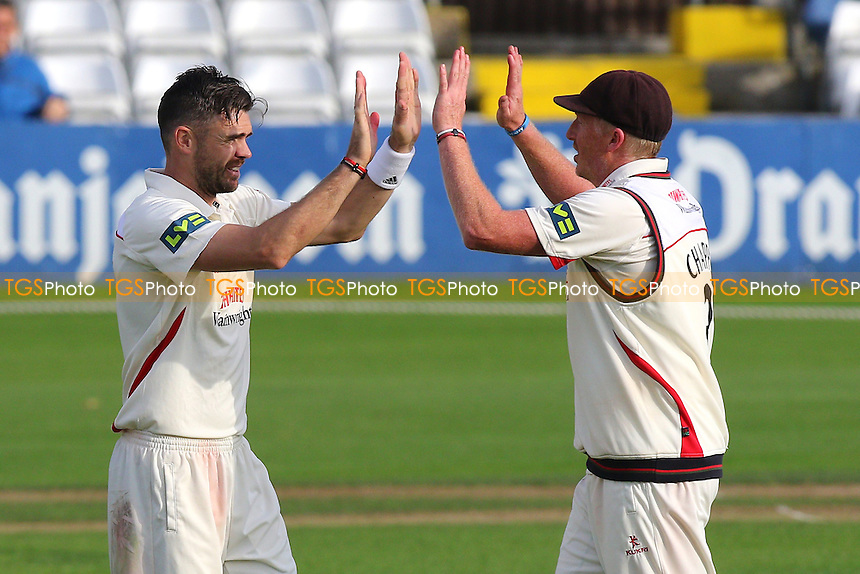 James Anderson of Lancashire (L) celebrates taking the wicket of Ravi Bopara during Essex CCC vs Lancashire CCC, Day Two
