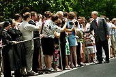 United States President George W. Bush greets visitors of the White House after he and first lady Laura Bush arrived via Marine One on the south lawn of the White House in Washington, DC after a weekend spent relaxing at Camp David in Maryland on June 19, 2005.<br /> Credit: Jay L. Clendenin / Pool via CNP