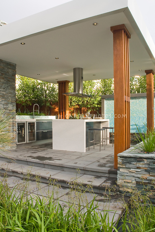 Outdoor Kitchen U0026 Covered Patio Home Landscaping With Dining Table,  Waterfall Water Feature, Ornamental