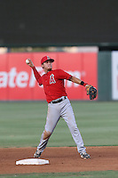 Angel Alamo (6) of the AZL Angels makes a throw from the field during a game against the AZL Giants at Tempe Diablo Stadium on July 6, 2015 in Tempe, Arizona. Angels defeated the Giants, 3-1. (Larry Goren/Four Seam Images)
