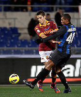 Calcio, semifinale di andata di Coppa Italia: Roma vs Inter. Roma, stadio Olimpico, 23 gennaio 2013..AS Roma forward Erik Lamela, of Argentina, and FC Inter defender Juan Jesus, of Brazil, right, fight for the ball during the Italy Cup football semifinal first half match between AS Roma and FC Inter at Rome's Olympic stadium, 23 January 2013..UPDATE IMAGES PRESS/Riccardo De Luca
