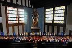FRANCE - Stack of candles burning in the churc  Sainte-Catherine in Honfleur. Kaarsen branden als verering voor de Heiligen in de houten historische kerk Sainte-Catherine in Honfleur in Normandie, bekend om zijn gescheiden klokketoren die jaarlijks vele toeristen trekt. TON BORSBOOM