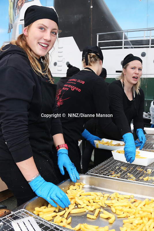 Ngai Tahu Seafoods food stall team serving their cooked battered oysters, blue cod and chips at the Bluff Oyster and Food Festival, Bluff, New Zealand, Saturday, May 21, 2016. Credit: Dianne Manson