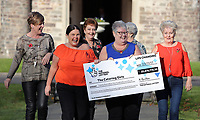 Pictured L-R: Julie Amphlett, Louise Ward, Julie Saunders, Sian Jones, Jean Cairns and Doreen Thompson with the check. Wednesday 08 November 2017<br /> Re: Presentation of hospital catering syndicate win &pound;25m in Euromillions Jackpot at Hensol Castle, south Wales, UK. Julie Saunders, 56, Doreen Thompson, 56, Louise Ward, 37, Jean Cairns, 73, SIan Jones, 54 and Julie Amphlett, 50 all work as catering staff for Neath Port Talbot Hospital in south Wales.