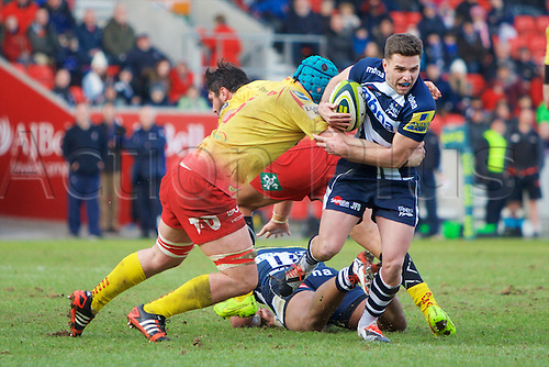 07.02.2015.  Sale, England.  LV Cup Rugby. Sale Sharks versus Scarlets. Sale Sharks fly-half Joe Ford is held up with the tackle.