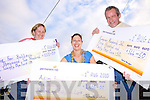 Fundraisers Bernadette Brosnan, Samantha Whetham and Patrick Flanagan with their  cheques for their chosen charity from The Happy Valley Weekend held in Mountcollins on the August bank holiday