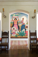 A painting from the Biltmore Hotel in Montecito enlivens the hallway