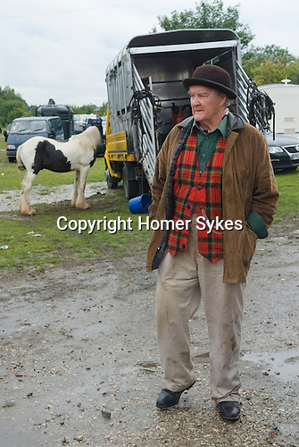 Brigg Horse Fair. Brigg Lincolnshire England 2009. Horse trader wearing Brown Derby bowler hat and tartan waistcoat.