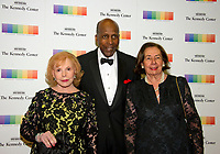 Buffy Cafritz, left, Vernon Jordan, center, and Ann Jordan arrive for the formal Artist's Dinner honoring the recipients of the 40th Annual Kennedy Center Honors hosted by United States Secretary of State Rex Tillerson at the US Department of State in Washington, D.C. on Saturday, December 2, 2017. The 2017 honorees are: American dancer and choreographer Carmen de Lavallade; Cuban American singer-songwriter and actress Gloria Estefan; American hip hop artist and entertainment icon LL COOL J; American television writer and producer Norman Lear; and American musician and record producer Lionel Richie. Photo Credit: Ron Sachs/CNP/AdMedia