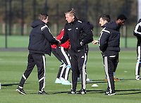 Pictured: Manager Garry Monk (C) and physiotherapist Richie Buchanan Wednesday 05 November 2014<br /> Re: Swansea City FC players training at Fairwood training ground, ahead of their Premier League game against Arsenal on Sunday.