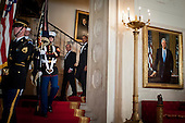 United States President Barack Obama and President Francois Hollande of France walk down the Grand Staircase in the White House before the State Dinner in Hollande's honor in Washington, District of Columbia, U.S., on Tuesday, Feb. 11, 2014.  After an arrival ceremony on the South Lawn, Obama and Hollande met in the Oval Office for a policy meeting then gave a joint press conference in the East Room of the White House.<br /> Credit: Pete Marovich / Pool via CNP