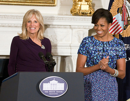 Dr. Jill Biden, left, and first lady Michelle Obama, right, make remarks prior to United States President Barack Obama and Vice President Joe Biden hosting a meeting with a bipartisan group of governors in the State Dining Room of the White House in Washington, D.C. on Monday, February 28, 2010..Credit: Ron Sachs / Pool via CNP