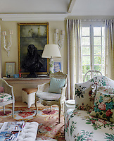 In the garden room a large wax maquette of Jean de Rotrou, a 17th century playwright, sits on a console table beside a small oil painting of Lucian Freud bought from the railings of St James' Park