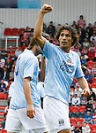 Manchester City's Bernardo Corradi celebrates scoring the equaliser