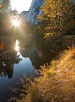 Yosemite National Park, California:<br /> Setting sun illuminating fall colors along the Merced river, Yosemite Valley