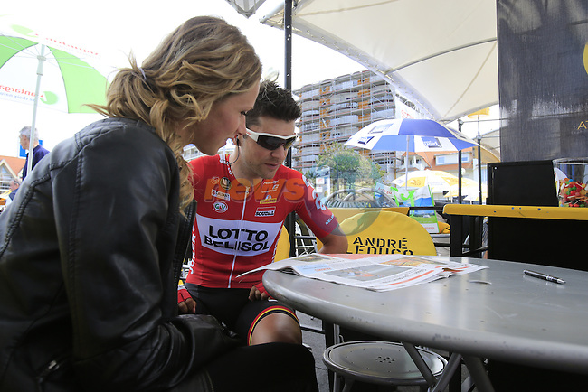 Tony Gallopin (FRA) Lotto-Belisol and his girl catch up with the news in the Tour Village in Le Touquet before the start of Stage 4 of the 2014 Tour de France running 163.5km from Le Touquet to Lille. 8th July 2014.<br /> Picture: Eoin Clarke www.newsfile.ie