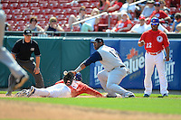 Charlotte Knights first baseman Mike McDade #17 can not come up with a throw in the dirt as Anthony Gose #8 dives back to first on a pick off attempt with umpire Jeff Gosney and first base coach Jon Nunnally #22 looking on during a game against the Buffalo Bisons on May 19, 2013 at Coca-Cola Field in Buffalo, New York.  Buffalo defeated Charlotte 11-6.  (Mike Janes/Four Seam Images)