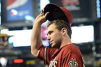 Arizona Diamondbacks first baseman Paul Goldschmidt (44) tips his cap to the fans after a game against the Washington Nationals at Chase Field on September 29, 2013 in Phoenix, Arizona.  Arizona defeated Washington 3-2.  (Mike Janes/Four Seam Images)
