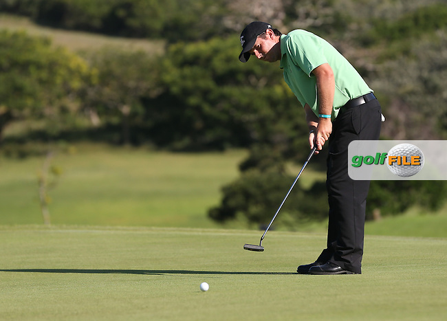 Thomas Aiken (RSA) putts for birdie during the Final Round play-off against Oliver Fisher (ENG) at The Africa Open 2014 at the East London Golf Club, Eastern Cape, South Africa. Picture:  David Lloyd / www.golffile.ie