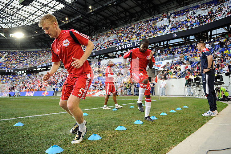 Tim Ream (5) and Ibrahim Salou (29) of the New York Red Bulls warm up prior to  a friendly between Santos FC and the New York Red Bulls at Red Bull Arena in Harrison, NJ, on March 20, 2010. The Red Bulls defeated Santos FC 3-1.