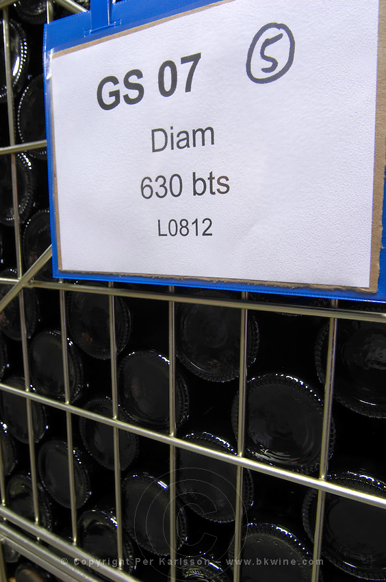 bottles stored in wire cages diam cork dom pfister dahlenheim alsace france