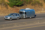 Airstream travel trailer on freeway.