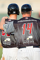 Kannapolis Intimidators manager Pete Rose Jr. (14) put his arm around the shoulder of Adam Engel (23) during the game against the Asheville Tourists at CMC-NorthEast Stadium on July 12, 2014 in Kannapolis, North Carolina.  The Tourists defeated the Intimidators 7-5 in 15 innings.  (Brian Westerholt/Four Seam Images)