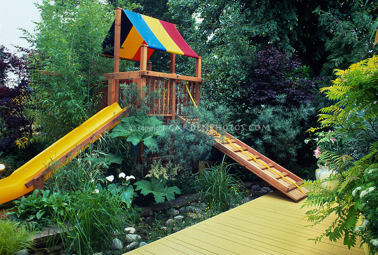 Brilliantly Colored Hi Tech Garden With Areas For Childrenu0027s Slide And  Treehouse. Design: