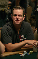 MATT DAMON.The Ante Up for Africa Celebrity Poker Tournament at the Rio Resort Hotel and Casino, Las Vegas, Nevada, USA..July 2nd, 2009.half length table bet betting chips cards grey gray t-shirt.CAP/ADM/MJT.© MJT/AdMedia/Capital Pictures