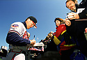 CIRCA 1997: Chipper Jones #10 of the Atlanta Braves signing autographs before a game from his 1997 season with the Atlanta Braves. Chipper Jones played for 19 years, all with the Atlanta Braves, was a 8-time All-Star,1999 National League MVP and was inducted to the Baseball Hall of Fame in 2018.(Photo by: 1997 SportPics)  *** Local Caption *** Chipper Jones