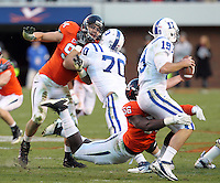 CHARLOTTESVILLE, VA- NOVEMBER 12:  Defensive end Cam Johnson #56 of the Virginia Cavaliers puts pressure on quarterback Sean Renfree #19 of the Duke Blue Devils during the game on November 12, 2011 at Scott Stadium in Charlottesville, Virginia. Virginia defeated Duke 31-21. (Photo by Andrew Shurtleff/Getty Images) *** Local Caption *** Cam Johnson;Sean Renfree