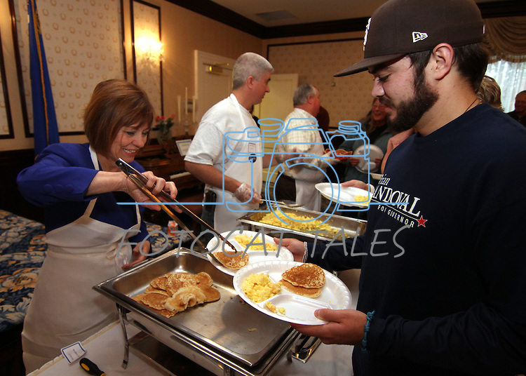 U.S. Senate candidate Sharron Angle serves pancakes to Matt Scherer during the annual Carson City Republican Women's Nevada Day Pancake Breakfast at the Governor's Mansion on Saturday morning, Oct. 30, 2010, in Carson City, Nev. .Photo by Cathleen Allison