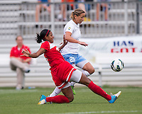 Candace Chapman (5) of the Washington Spirit tackles the ball away from Inka Grings (21) of the Chicago Red Stars during the game at the Maryland SoccerPlex in Boyds, Md.   Chicago defeated Washington, 2-0.